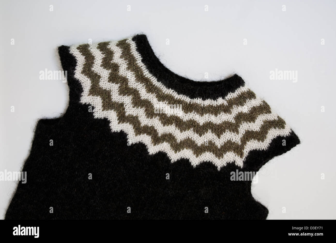 Close up cut out of a knitted Icelandic woman's sweater vest in earth tones, woolens handmade in Iceland, Europe - Stock Image