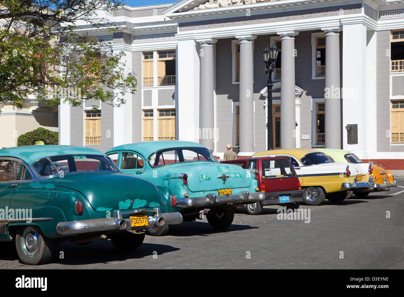 Old 1950s vintage American cars / Yank tank parked in front of the ...