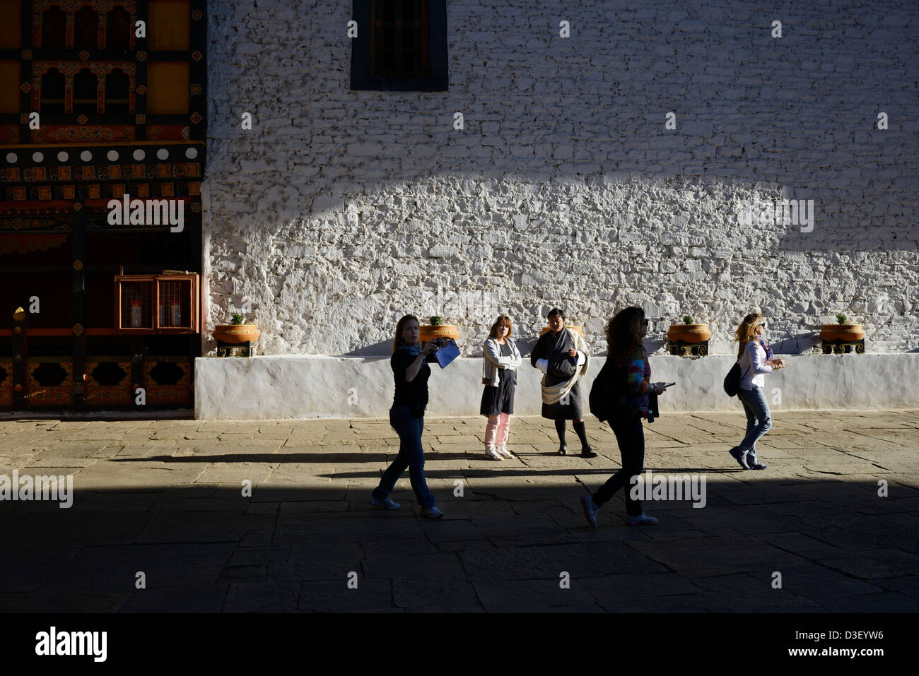 Paro Dzong,a beautiful fortress,wonderful Bhutanese style of architecture in courtyard,tourists look annoyed,36MPX,HI - Stock Image