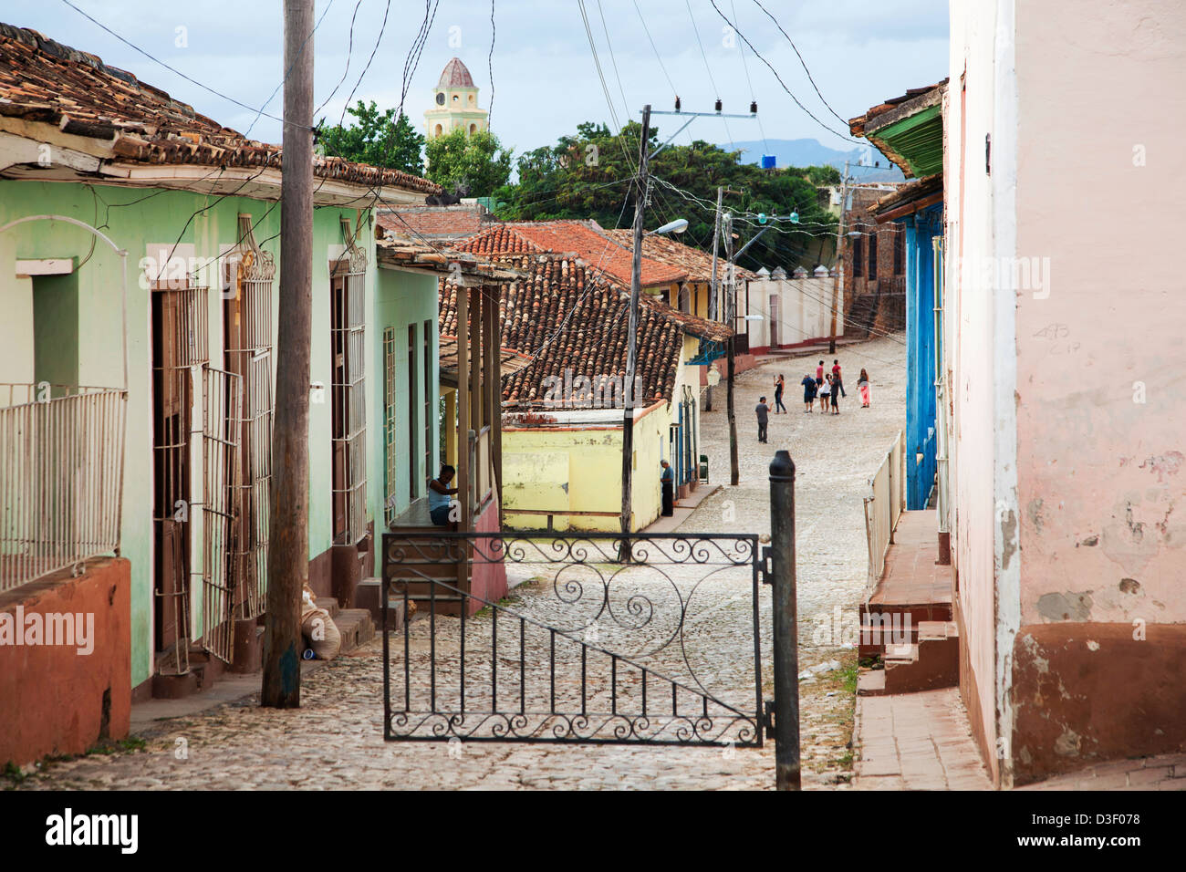 Colonial street with pastel coloured houses in the center of Trinidad, Cuba - Stock Image