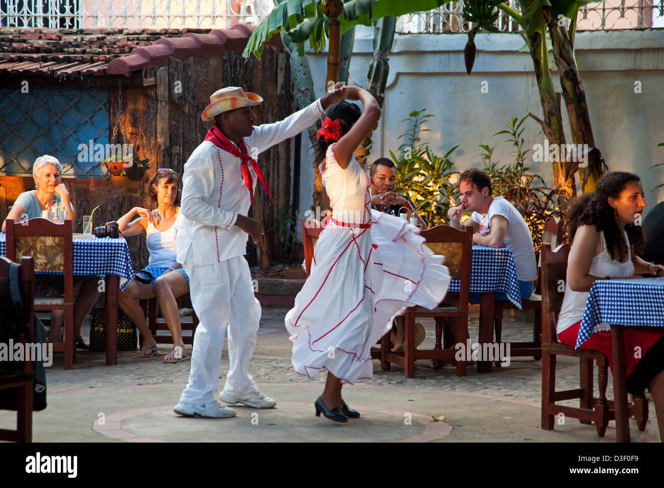 Cuban couple dancing Spanish style for tourists in an open air bar in Trinidad, Cuba - Stock Image