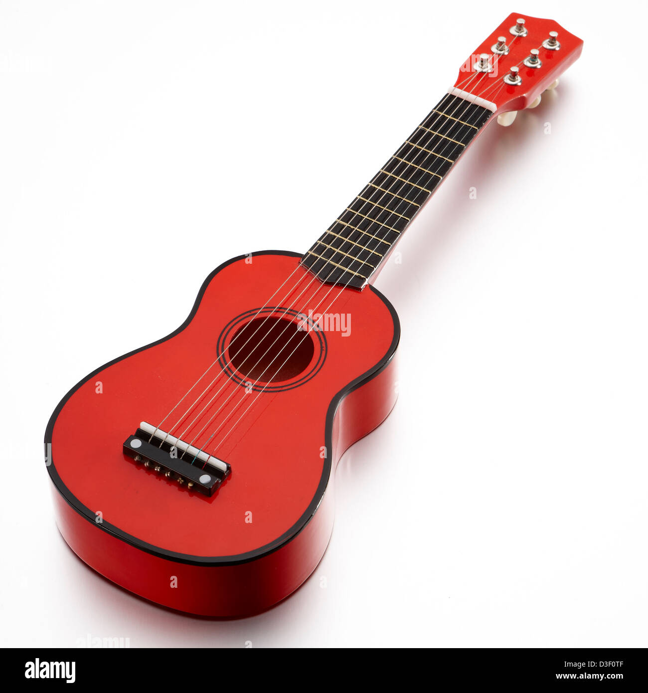 Red wooden toy guitar 6 string - Stock Image