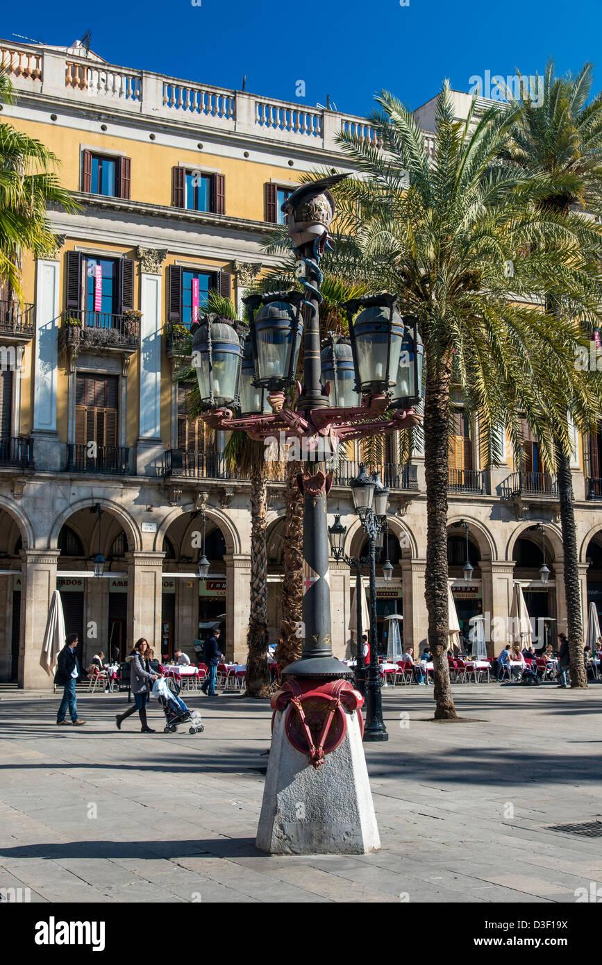Street lamp designed by Antoni Gaudi in Plaza Real or Placa Reial, Barcelona, Catalonia, Spain - Stock Image