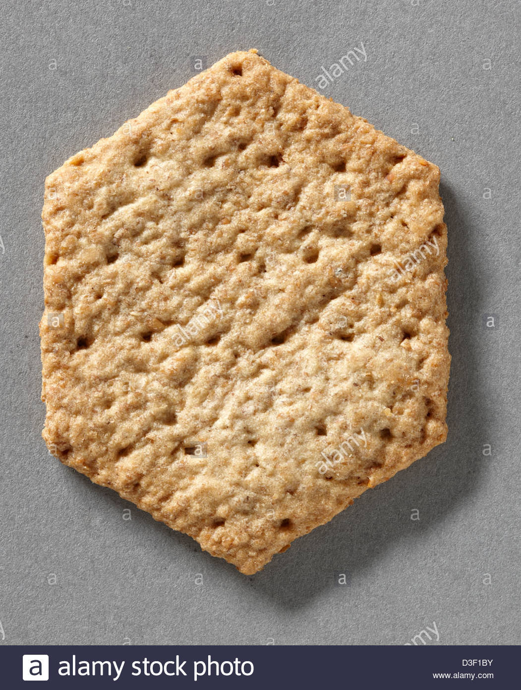 Hexagonal baked savory biscuit for cheese - Stock Image
