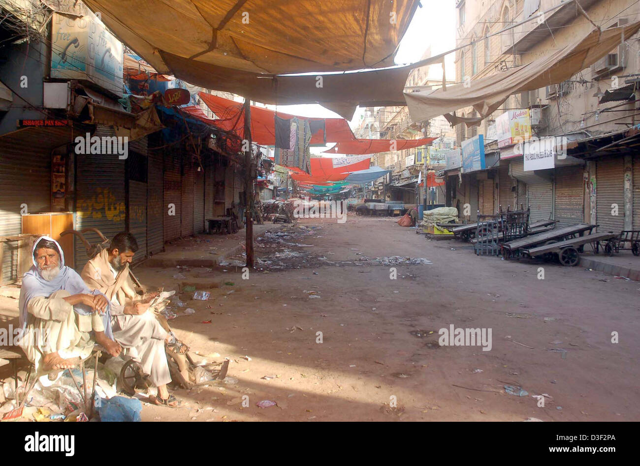 Shops seen closed during shutter down strike called by Shia  Ulema Council (SUC) against bomb blast at a grocery - Stock Image