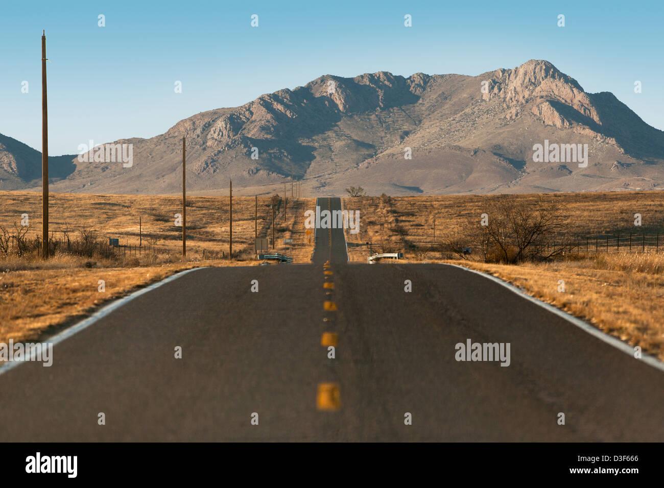 Long desert road in southern Arizona. - Stock Image