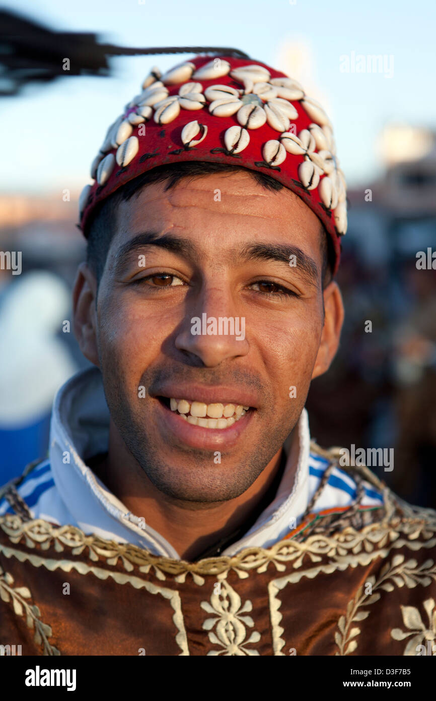 Morocco, Marrakesh, Moroccan man posing for tourists at the Place Jemaa-el-Fna (square). Stock Photo