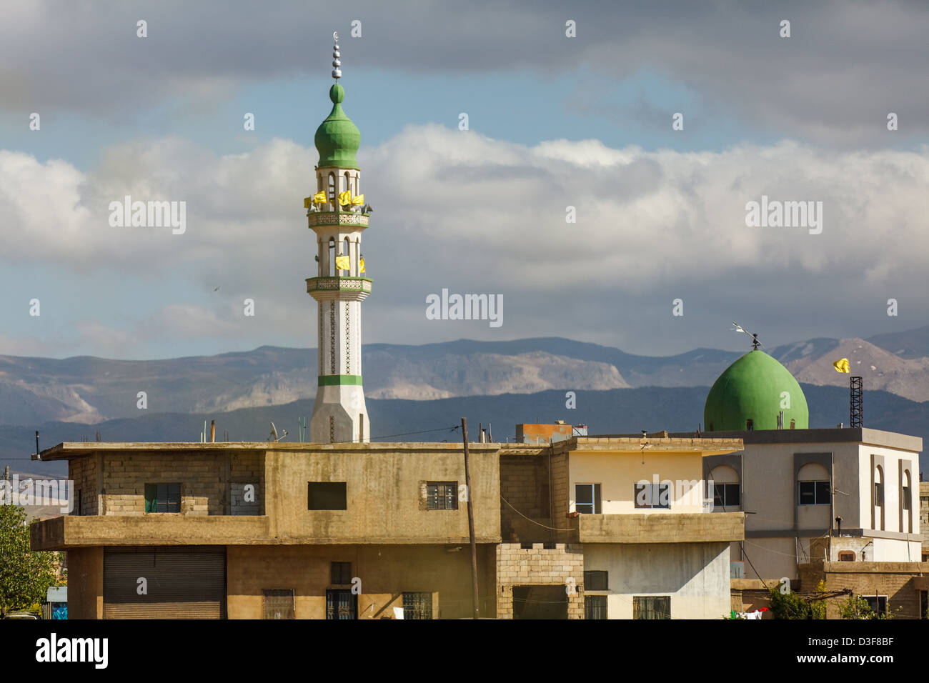 Mosque with Hezbollah flags in the Beqaa Valley, Lebanon. - Stock Image