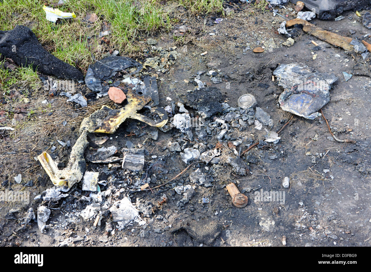 litter and rubbish burned in a public park in Belfast Northern Ireland UK - Stock Image
