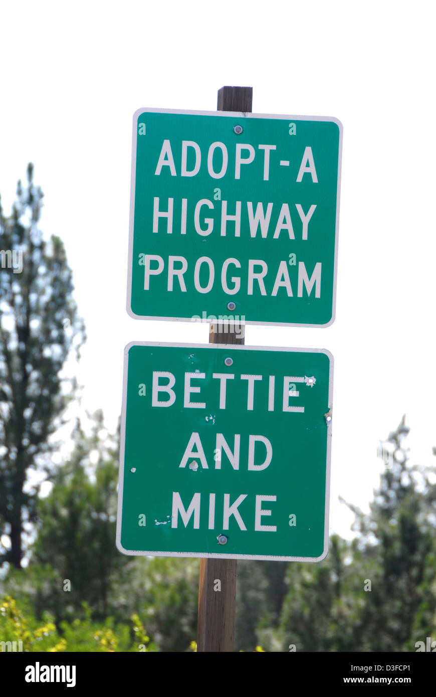 Adapt-A Highway sign along a highway in Eastern Oregon. - Stock Image