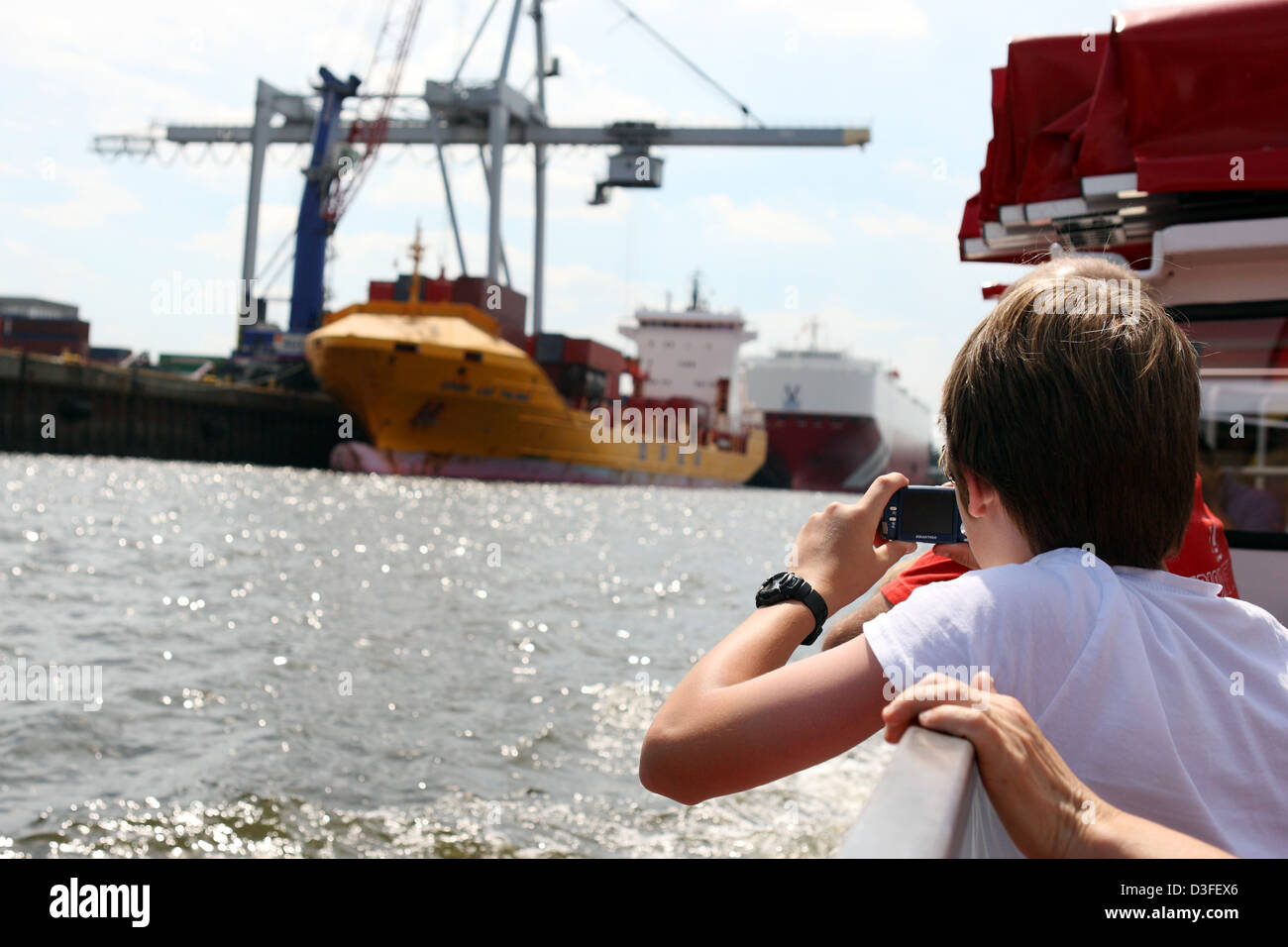 Hamburg, Germany, boy photographed a container ship in the Port of Hamburg - Stock Image