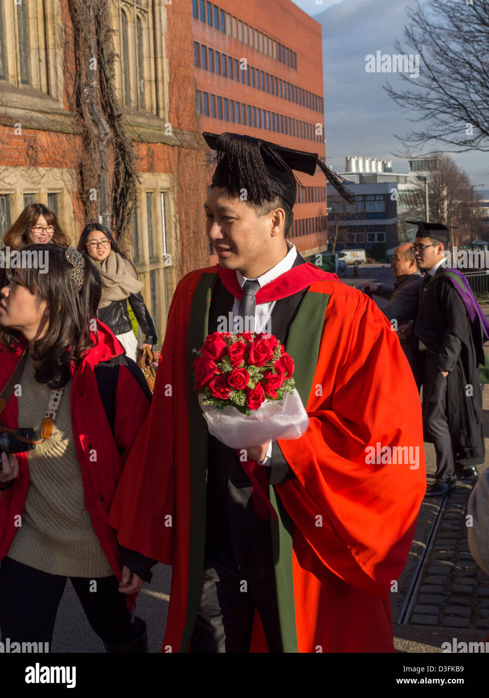 New graduates on graduation day wearing caps and gowns around the campus of University of Sheffield South Yorkshire - Stock Image