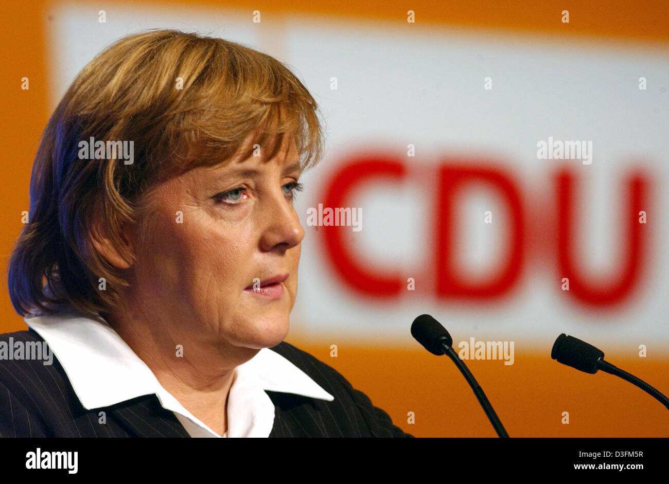 (dpa) - Angela Merkel, Leader of the German Christian Democratic Union (CDU), talks to delegates during the CDU's 18th party congress in Duesseldorf, Germany, 7 December 2004. The party congress took place under the motto 'Deutschlands Chancen nutzen' (to use Germany's chances). Stock Photo