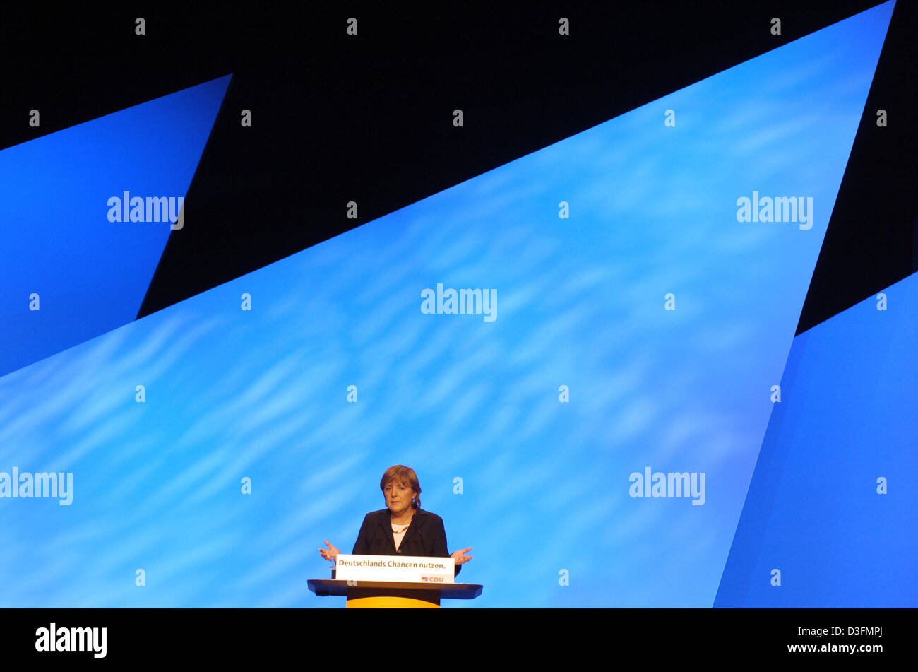 (dpa) - Angela Merkel, Leader of the German Christian Democratic Union (CDU), gives a speech in front of the stage decoration during the CDU's 18th party congress in Duesseldorf, Germany, 6 December 2004. The party congress takes place under the motto 'Deutschlands Chancen nutzen' (to use Germany's chances). Stock Photo