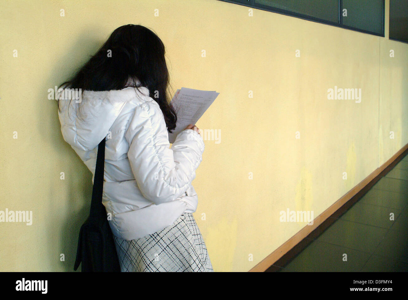 (dpa) - A female student reads a handout at the community college's hall in Frankfurt, Germany, 19 November 2004. Stock Photo