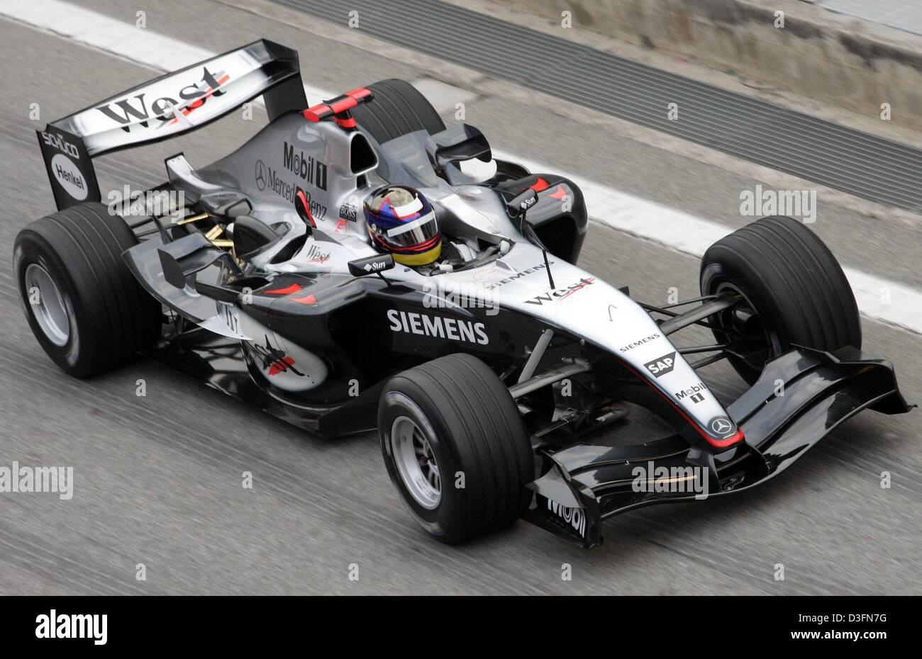 dpa-columbian-formula-1-driver-juan-pablo-montoya-drives-in-a-mclaren-D3FN7G.jpg