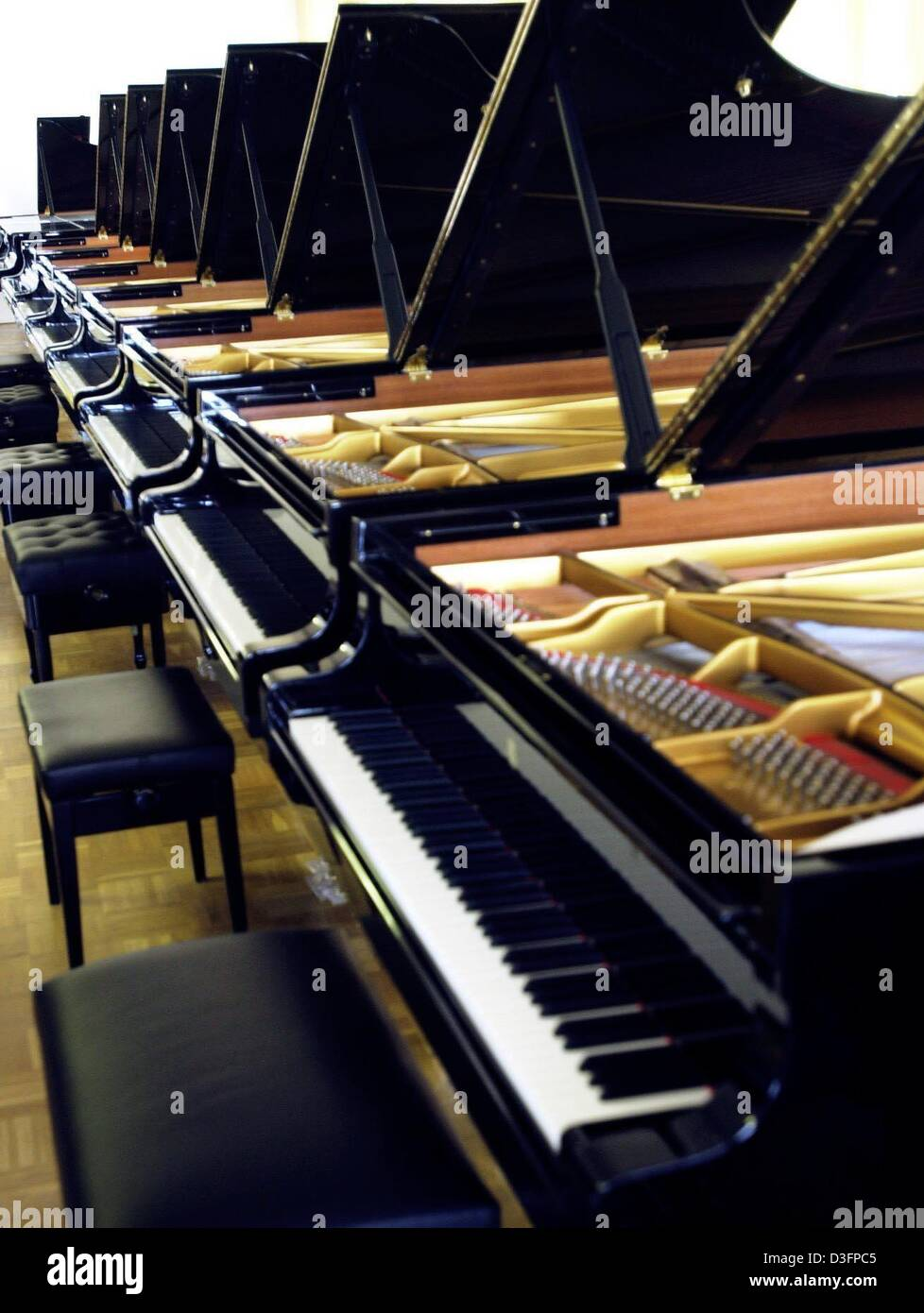 dpa) - Grand pianos are lined up to be test-played at the