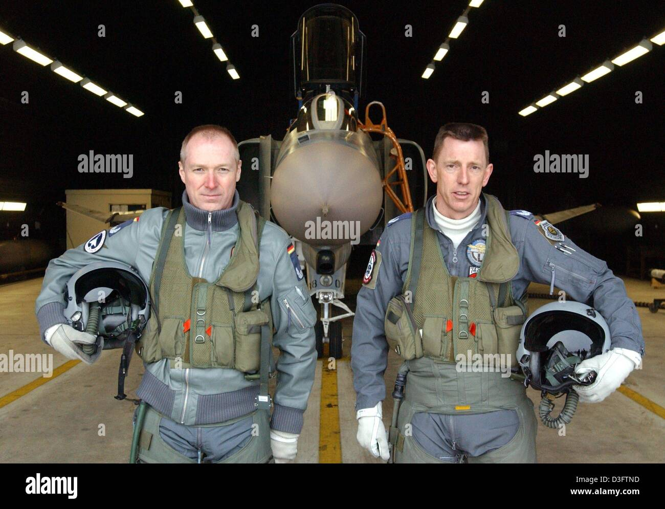 (dpa) - Two pilots pose in front of their warplane, a Mc Donnell Douglas Phantom F-4F Phantom II, at the air base Stock Photo