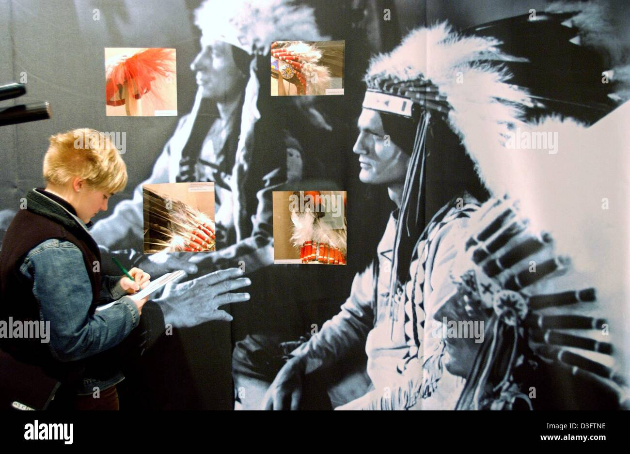 (dpa) - A visitor takes notes at the current 'Winnetou' exhibition at the Film Museum in Frankfurt, 11 March - Stock Image