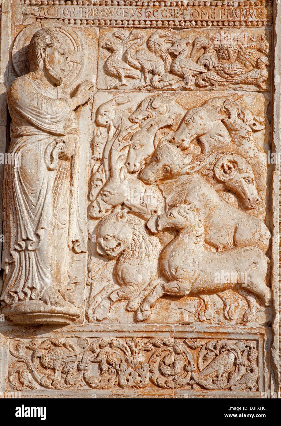 VERONA - JANUARY 27: Relief of creation from facade of romanesque Basilica San Zeno. - Stock Image