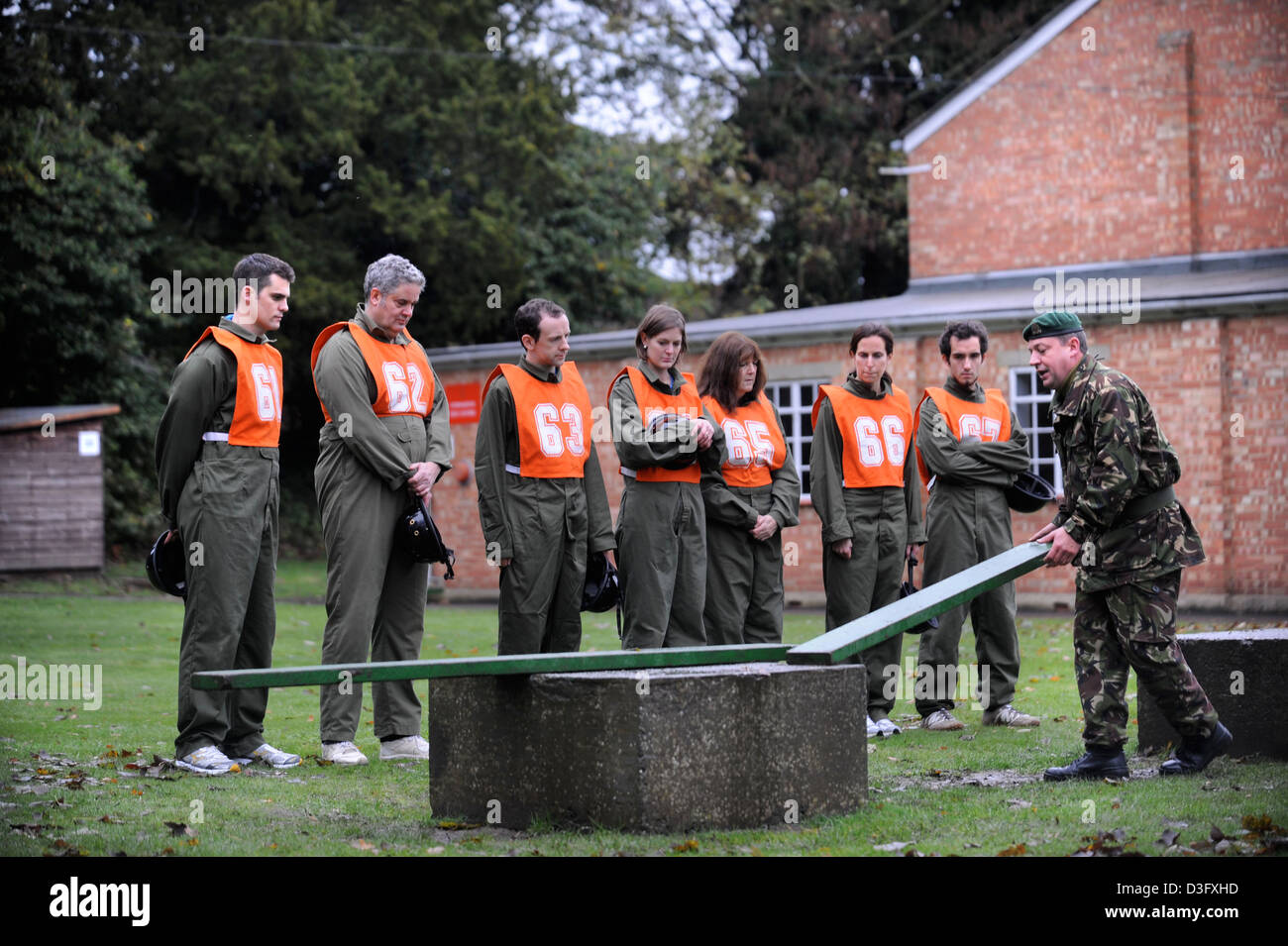 Older candidates experiencing the tasks icluding essential knots required of potential recruits at the Army Officer - Stock Image