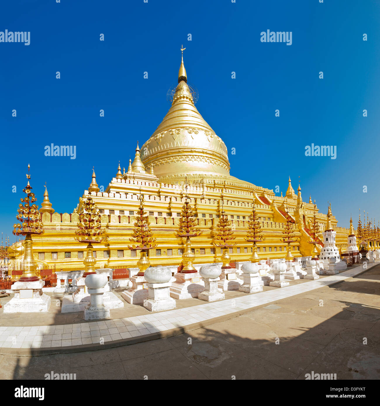 11th Century Shwezigon Pagoda in Bagan in Myanmar (formerly Burma). This is a stitch of several images. Stock Photo