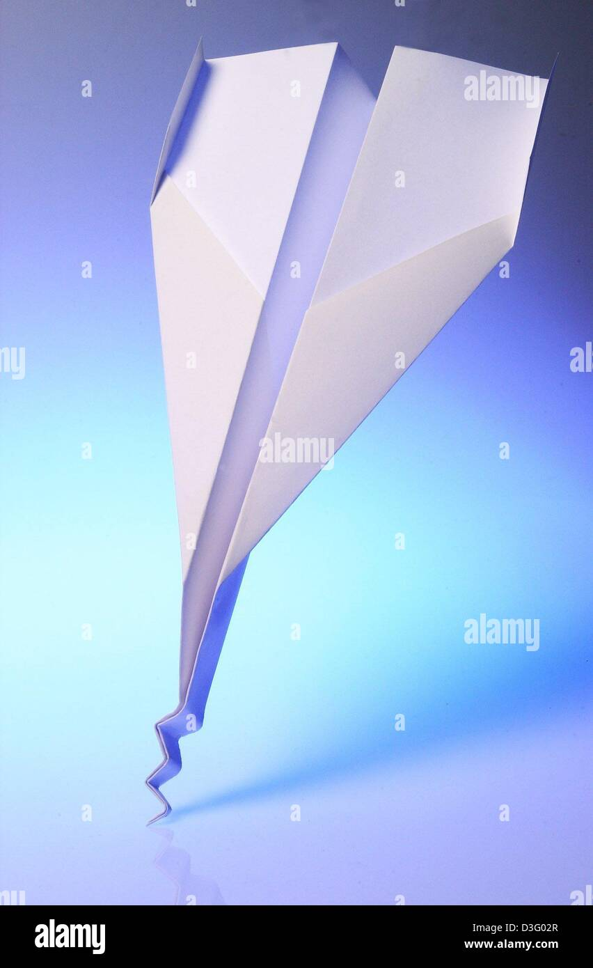 (dpa) - The symbolic picture shows a paper airplane with a demolished front, Hamburg, Germany, 14 April 2003. Worldwide, - Stock Image