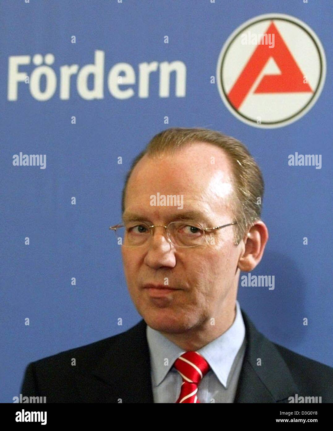 (dpa) - Florian Gerster, head of the German Federal Employment Office, stands in front of the logo of the Federal - Stock Image