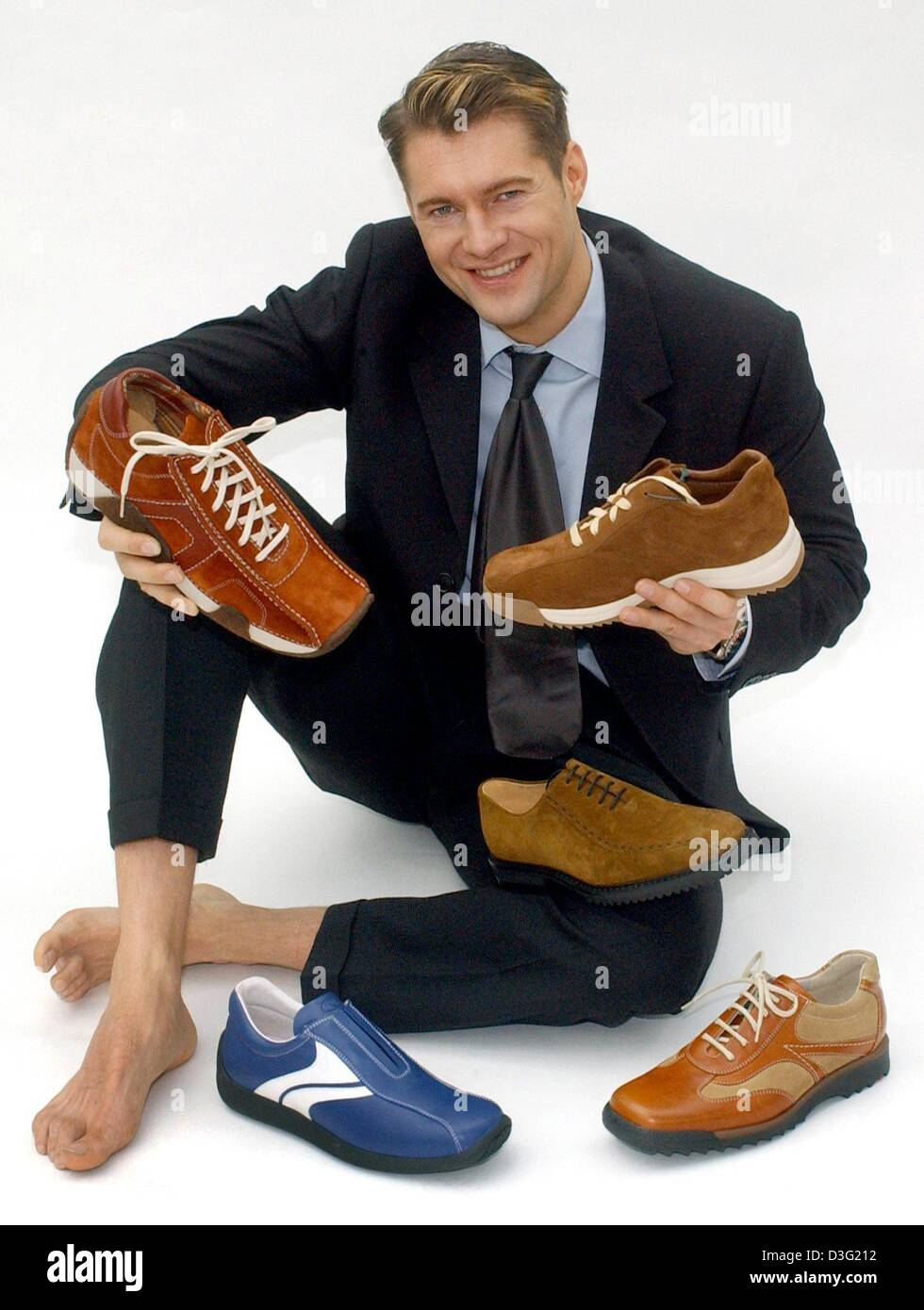 (dpa) - Model Tiberius, a model, presents the latest collection of shoes for men for the autmn and winter season - Stock Image