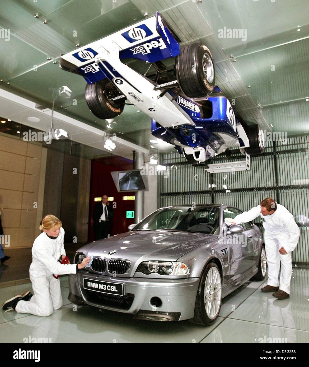 (dpa)   Employees Of BMW Car Manufacturer Wax And Polish BMWu0027s New Model  U0027M3 CSLu0027 And From The Ceiling Hangs A Formula One Racing Car With A BMW  Engine In ...