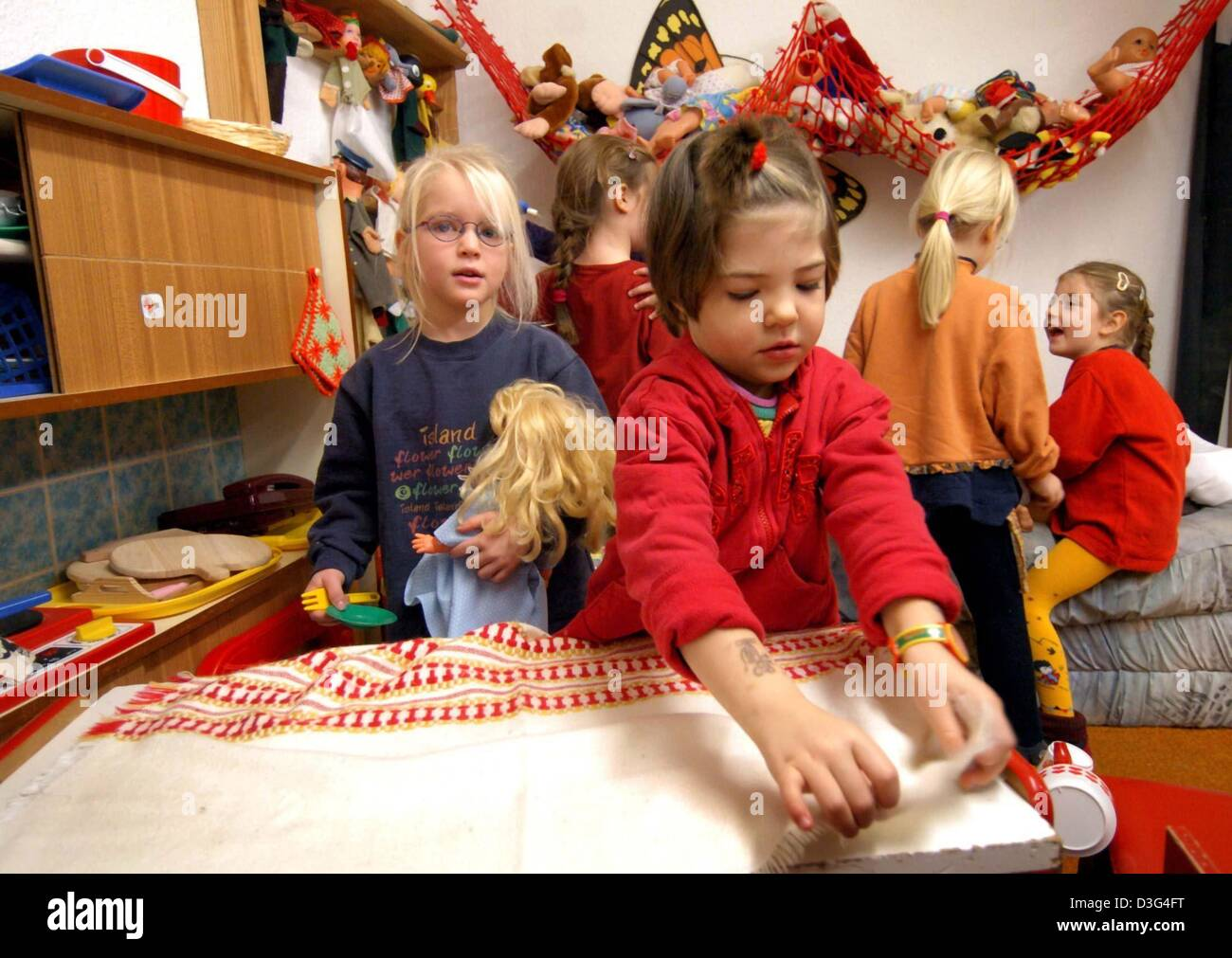 dpa Girls play with dolls in the dolls kitchen corner at the