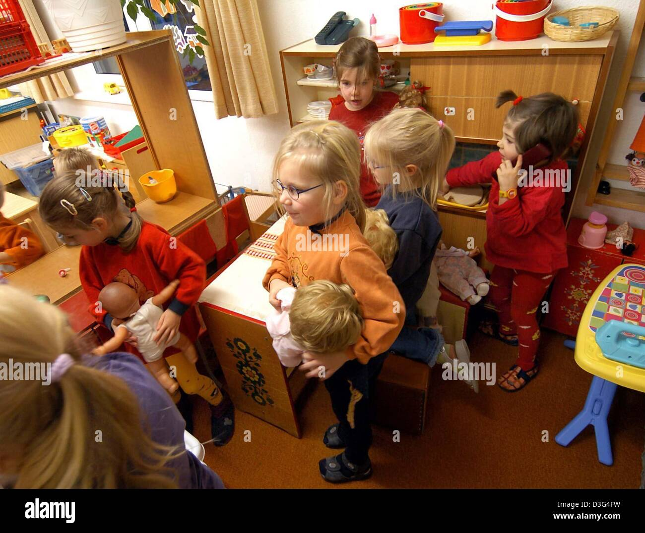 dpa Girls play with dolls at the daycare kindergarten centre in