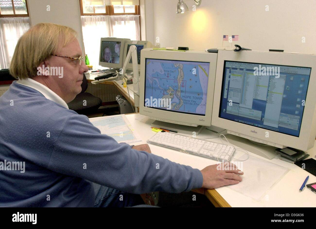 (dpa) - Cartographer Folke Stender works on a sea chart on his computer in Arnis an der Schlei, northern Germany, - Stock Image