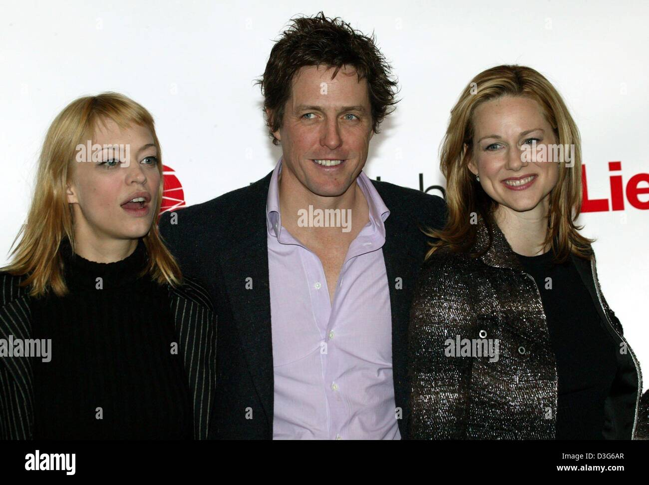 (dpa) - The lead cast of 'Love Actually', German actress Heike Makatsch (L) and her British colleagues Hugh - Stock Image