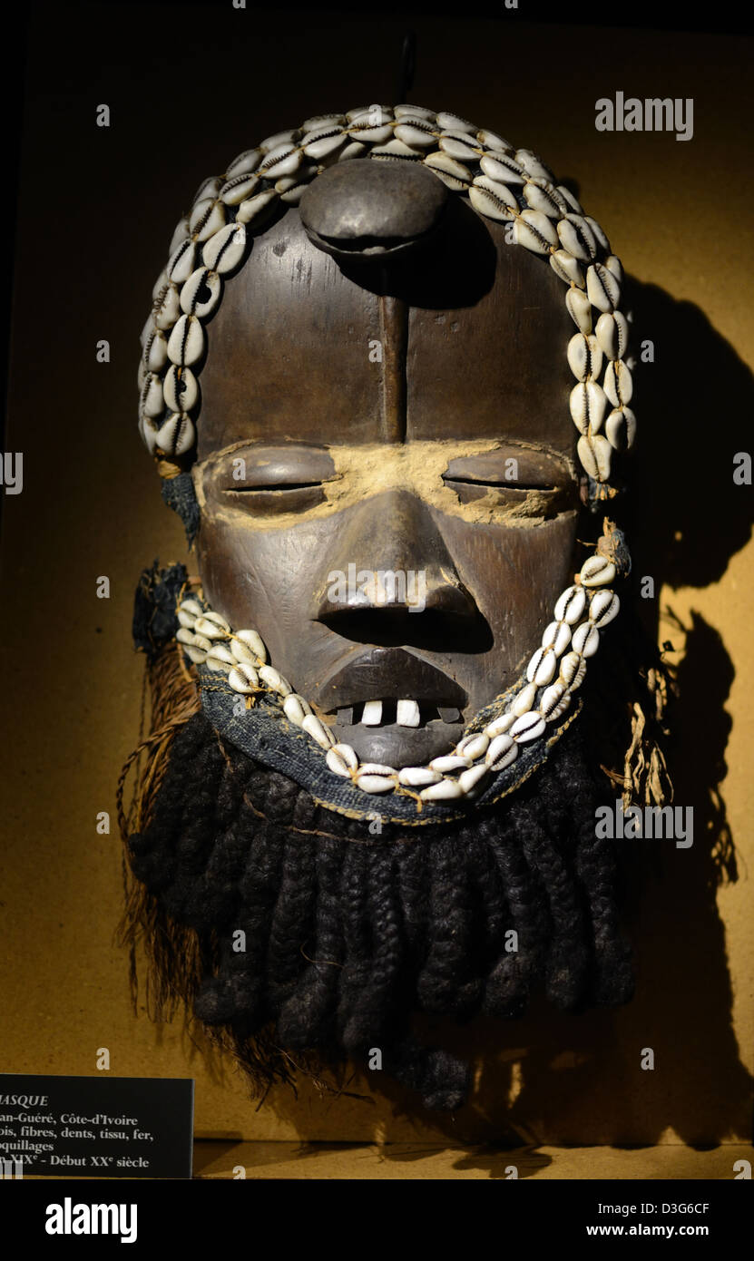 Tribal Art or Mask from Ivory Coast Wood Fiber Teeth Iron Shells end c19th beg c20th Vieille Charité Museum - Stock Image