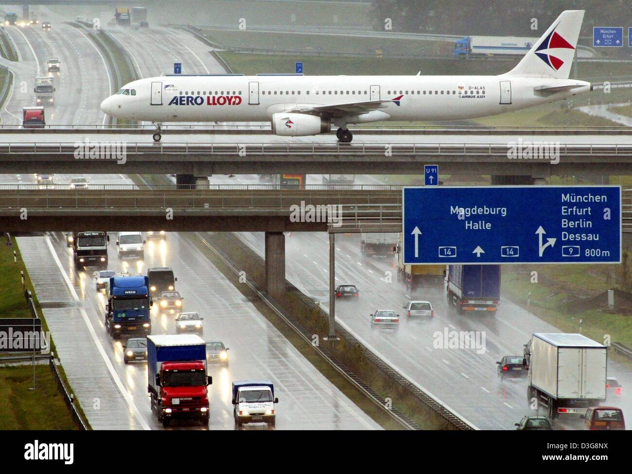 (dpa) - An Airbus A 321 of the German charter carrier Aero Lloyd rolls along the runway bridge across the A14 motorway Stock Photo