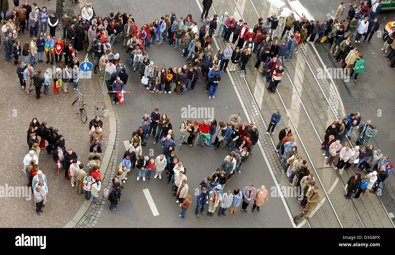 (dpa) - Around 300 people gather on the streets and form two words which read 'Stop Nazis' during a rally - Stock Image