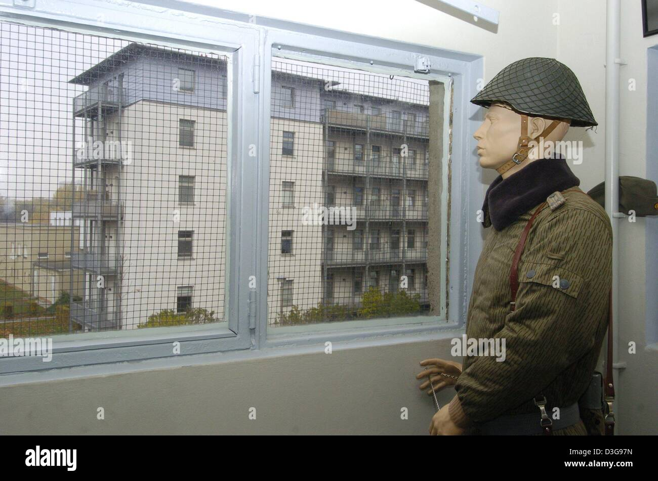 dpa) - A puppet in GDR uniform stands next to a window of the Stock