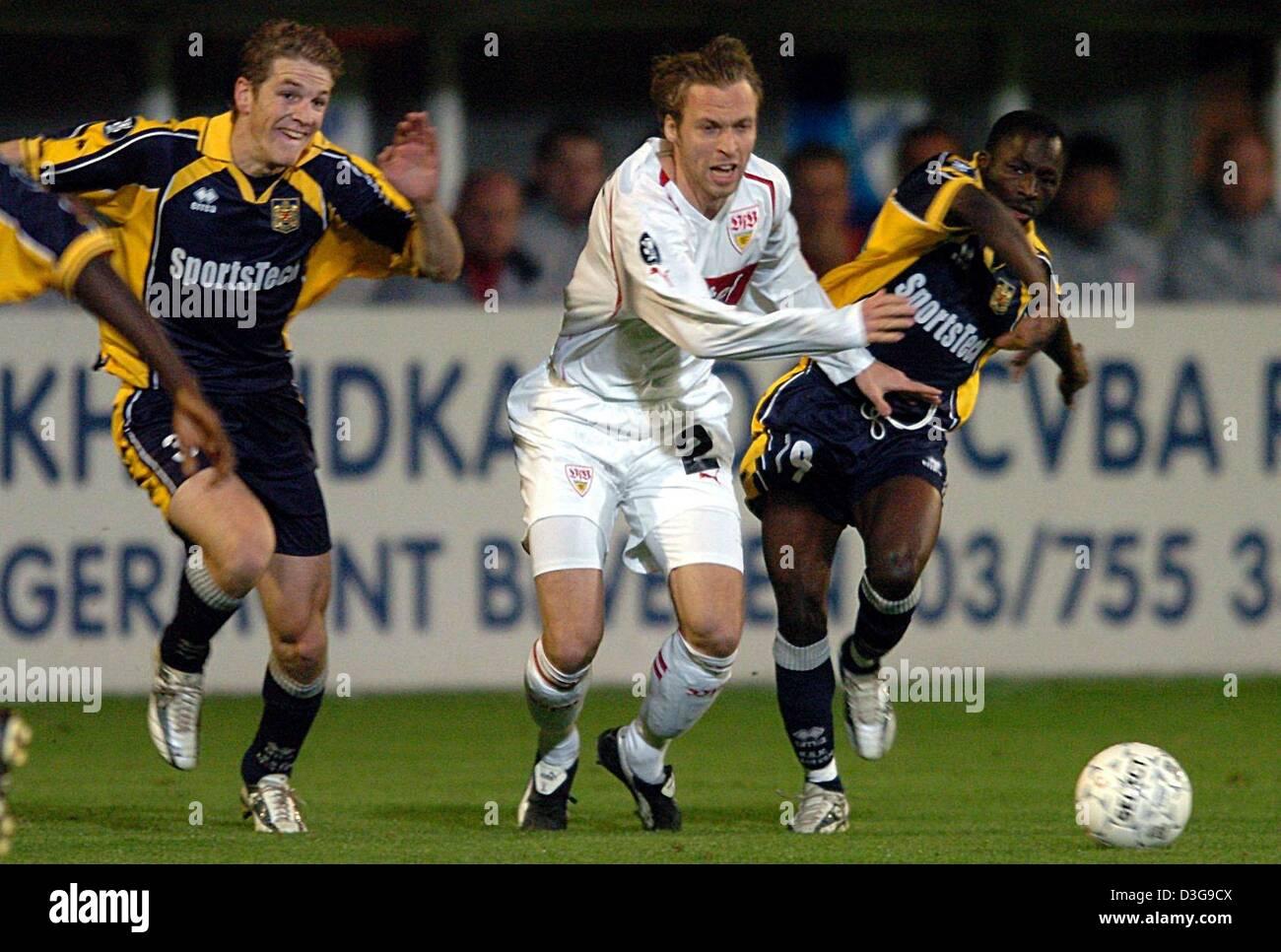 (dpa) - Beveren's players Kristof Lardenoit (L) and Badjan Kante Seydou (R) fight for the ball with Stuttgart's Stock Photo