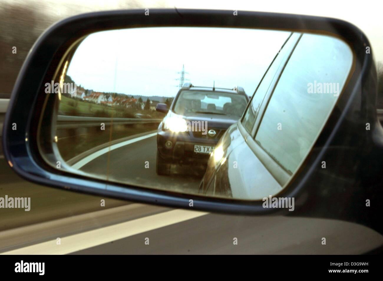 dpa files) - a following car flashing its headlights urges a stock