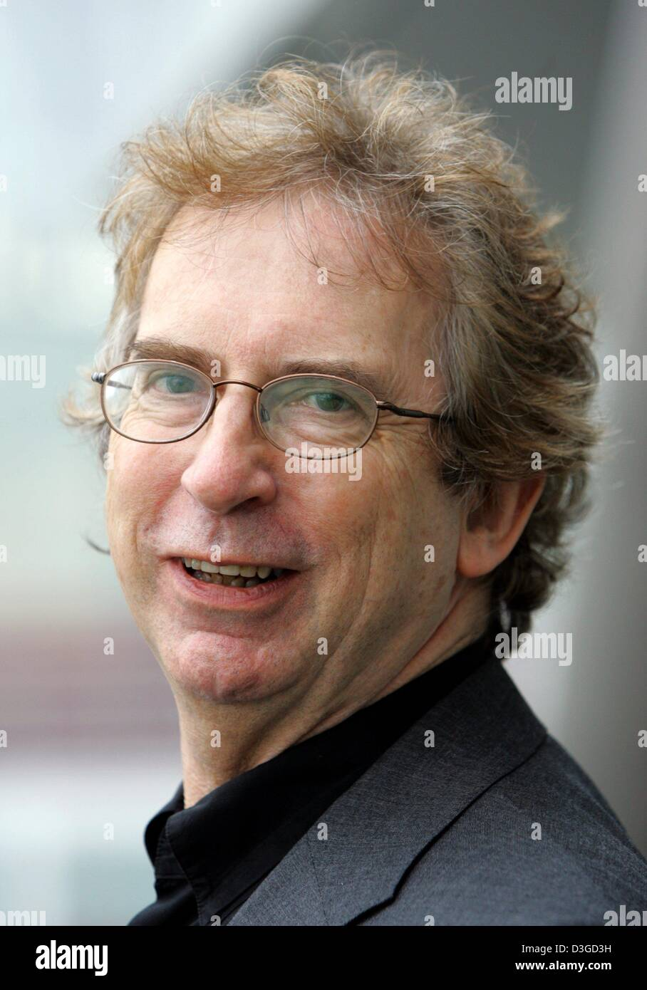 (dpa) - Australian author Peter Carey smiles during the Book Fair in Frankfurt, Germany, 6 October 2004. At the - Stock Image