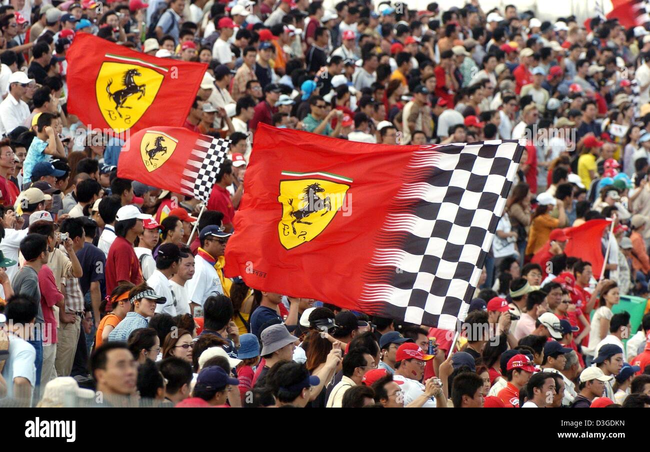 (dpa) - Chinese fans jubilate during the Chinese Grand Prix at the new  Shanghai