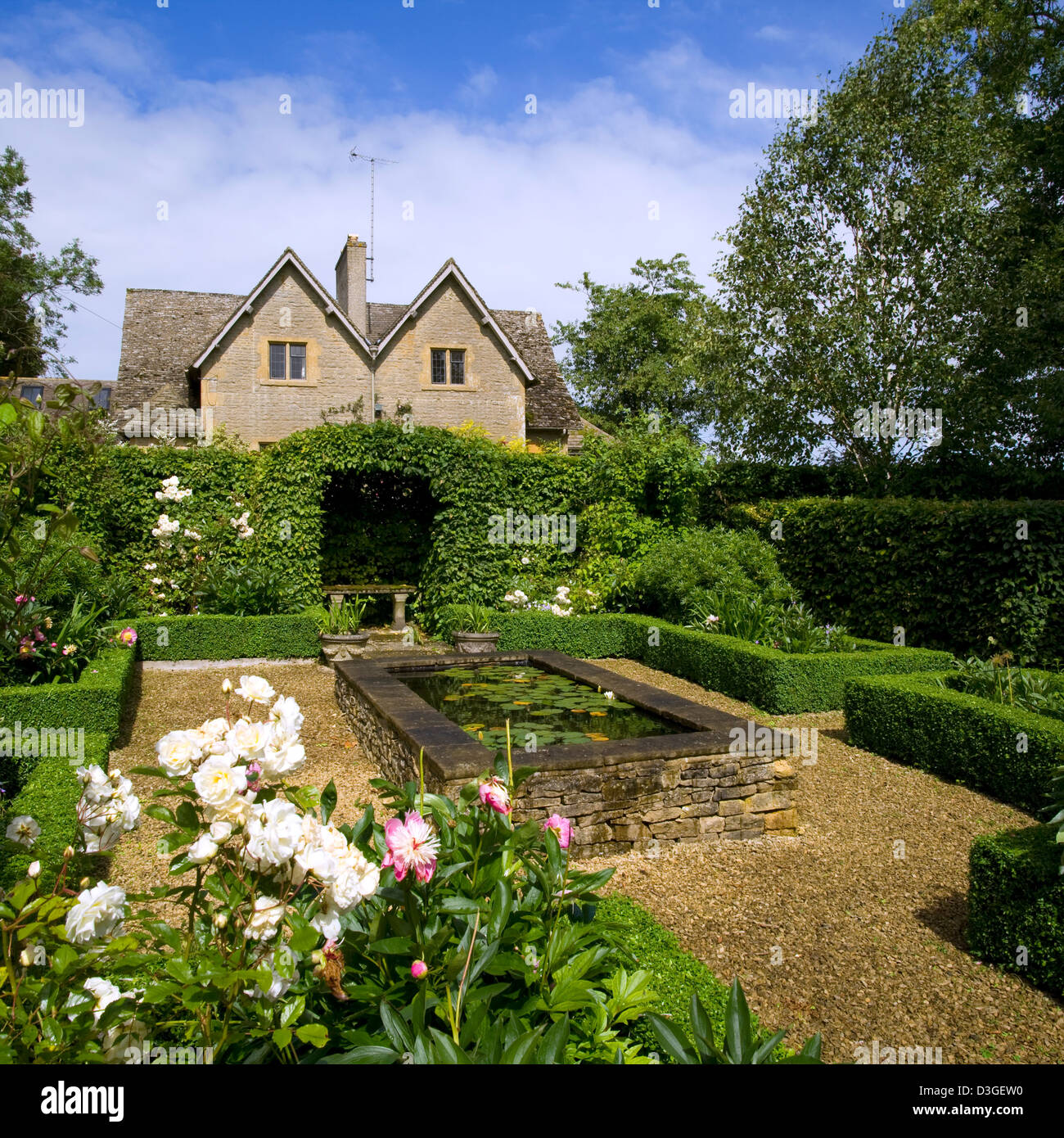 Wildlife Pond Surrounded By Pebbles: Raised Garden Pond Uk Stock Photos & Raised Garden Pond Uk