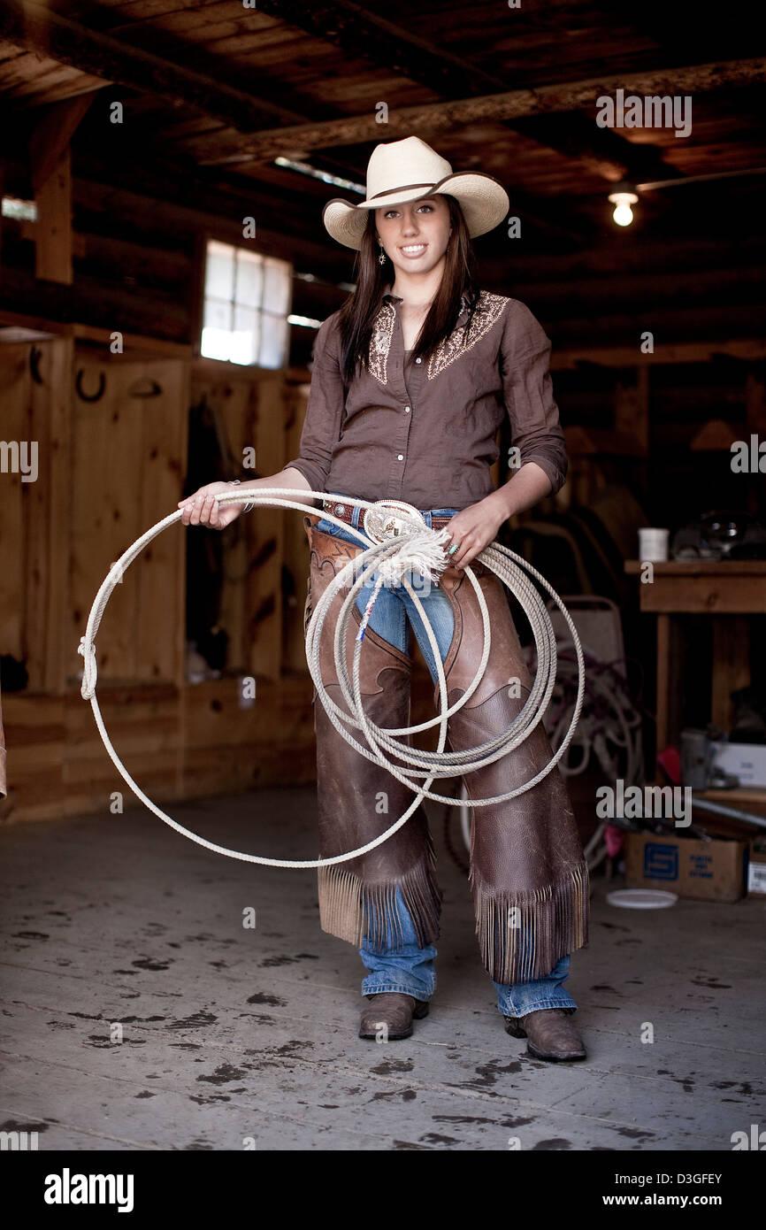 Cowgirl wrangler with lasso, ranching, Montana, USA - Stock Image