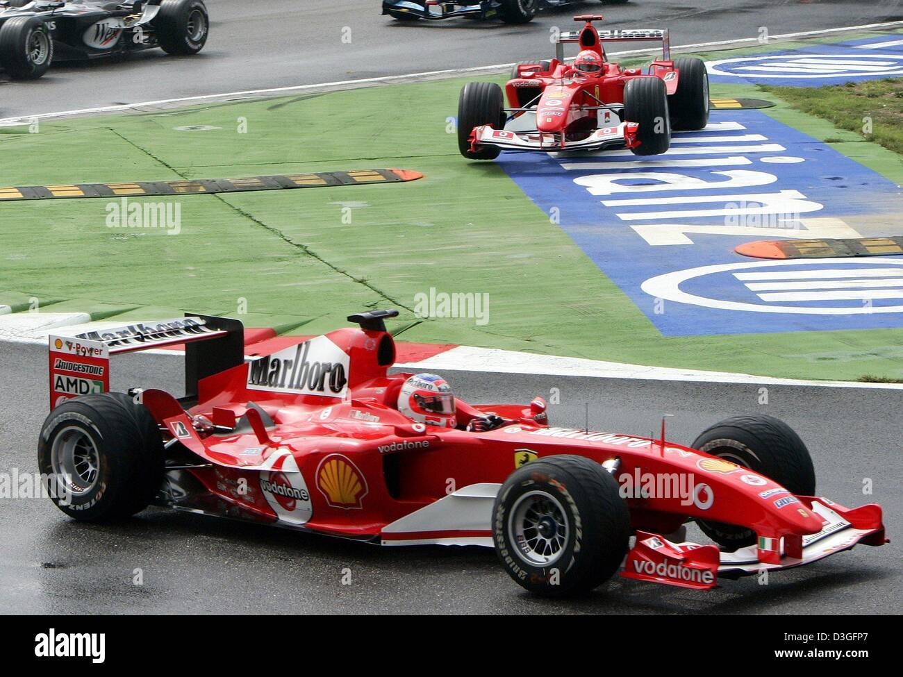 (dpa)   Ferrari Formula 1 Driver Rubens Barrichello (front) From Brazil Is