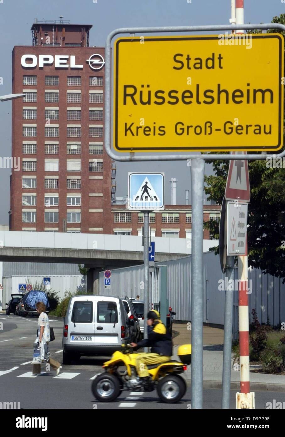 (dpa) - A view of the city limit sign is seen in front of the Opel car factory, a subsidiary of General Motors, - Stock Image