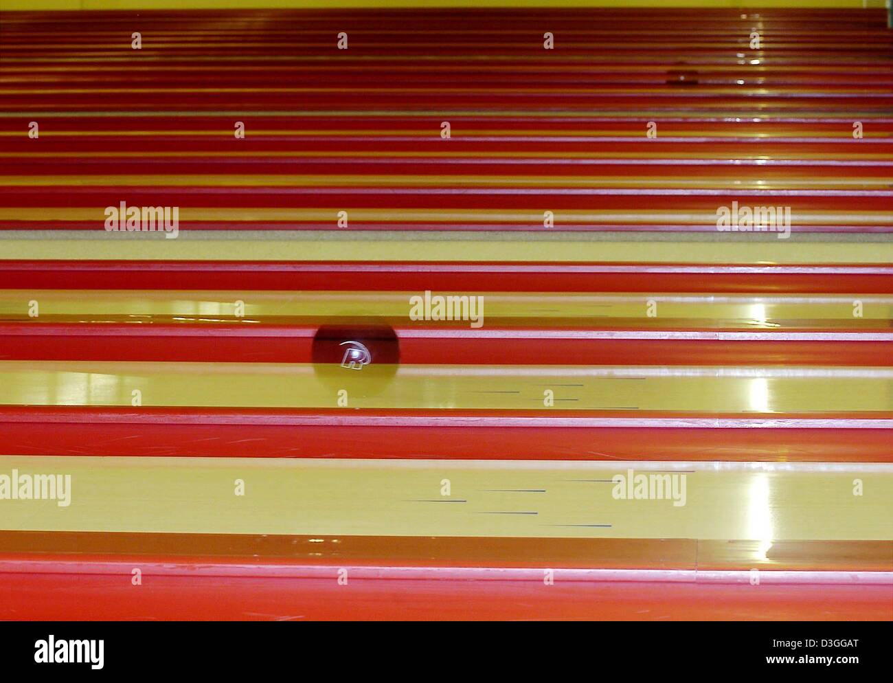 dpa) - A bowling ball rolls down the lane at a bowling alley in ...