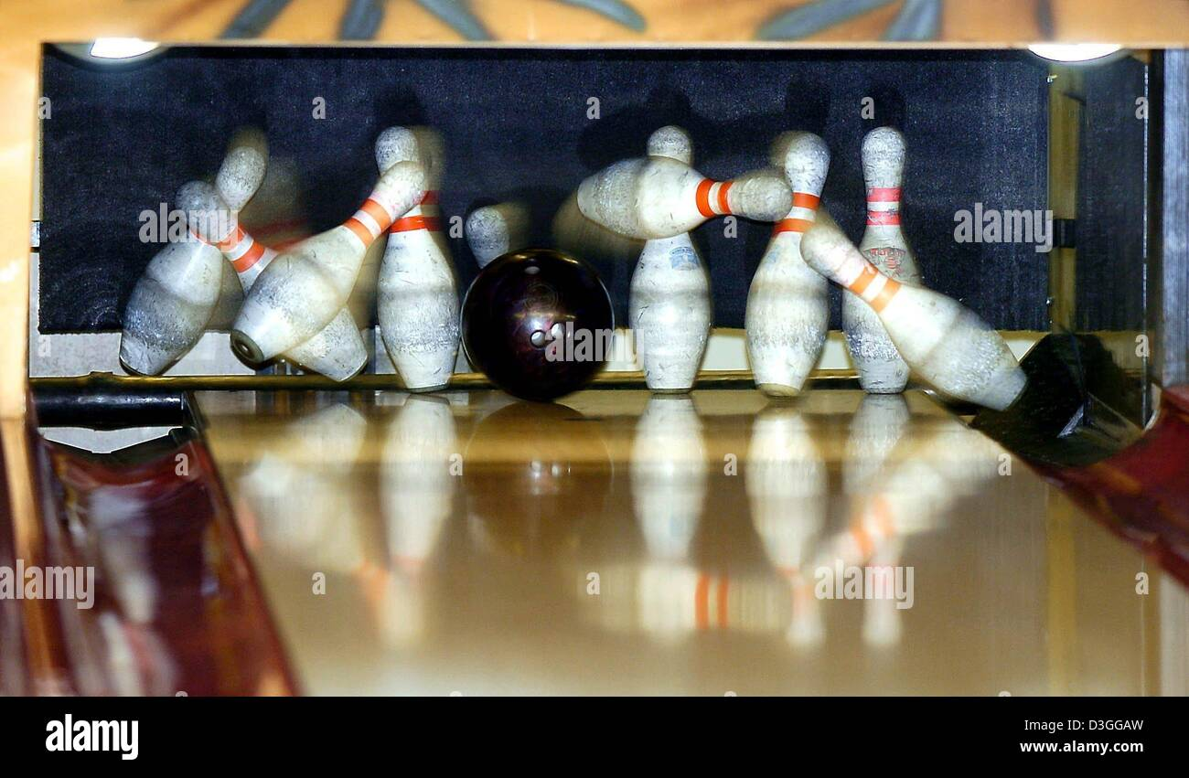 dpa) - A bowling ball crashes into the pins at a bowling alley in ...