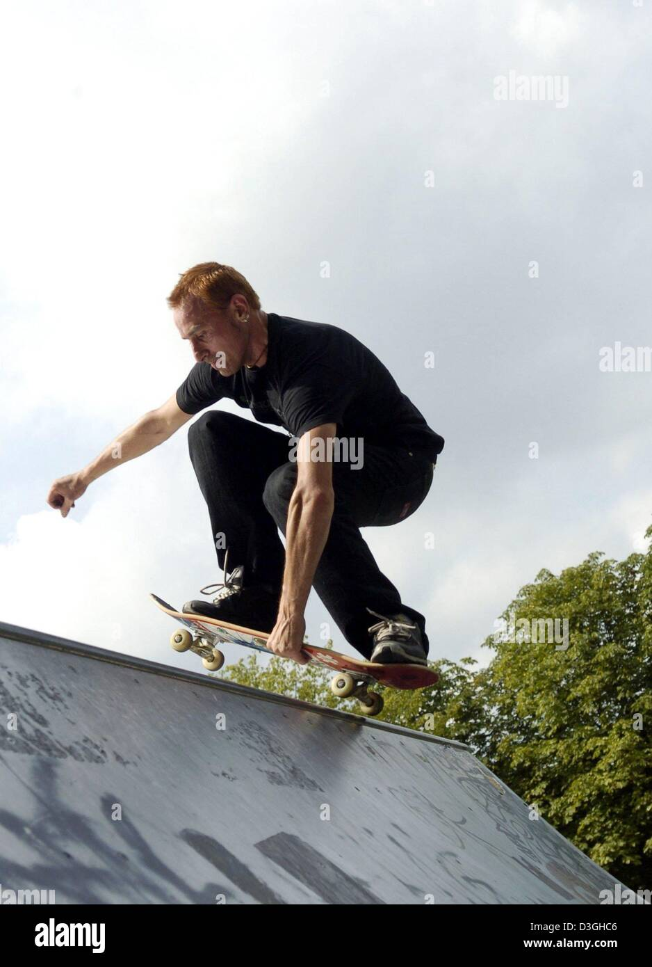 (dpa)   A Scater In Action On A Half Pipe In Berlin, 17