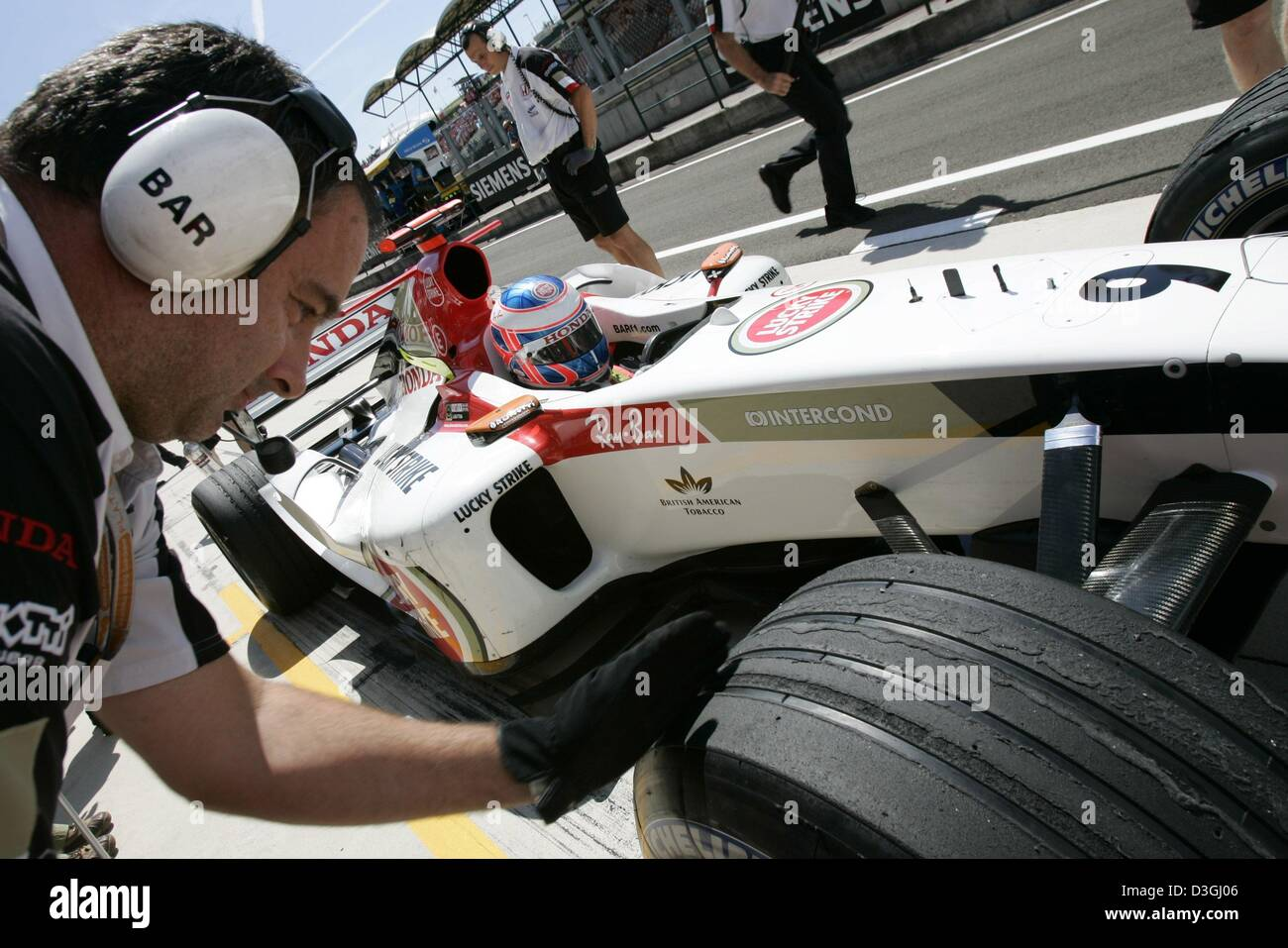 3a0bdada65f (dpa) - British formula one pilot Jenson Button stops his BAR Honda racing  car in front of his pit during the first free training at the Hungaroring  racing ...